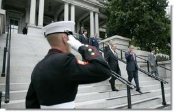 President George W. Bush walks downs the steps of the Dwight D. Eisenhower Executive Office Building with Defense Secretary Donald Rumsfeld after signing H.R.4613.  White House photo by Eric Draper