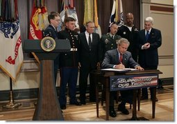 President George W. Bush signs H.R.4613, The Defense Appropriations Act for Fiscal Year 2005, in the Dwight D. Eisenhower Executive Office Building Thursday, Aug. 5, 2004.   White House photo by Eric Draper