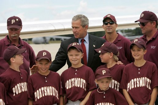 President George W. Bush greets members of the Portsmouth Little League baseball team after arriving at Pease Air National Guard base in Portsmouth, New Hampshire, Friday, Aug. 6, 2004. White House photo by Eric Draper.