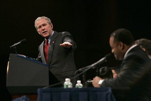 President George W. Bush takes questions from a panel of journalists at the UNITY: Journalists of Color Conference in Washington, D.C., Friday, Aug. 6, 2004. White House photo by Eric Draper.