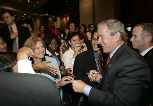 After delivering remarks and taking several questions, President George W. Bush greets audience members at the 2004 UNITY: Journalists of Color conference in Washington, D.C., Friday, Aug. 6, 2004.The convention is a nation-wide meeting of the National Association of Black Journalists, the National Association of Hispanic Journalists, the Asian American Journalists Association and the Native American Journalists Association. White House photo by Eric Draper.