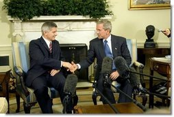 President George W. Bush and Prime Minister Marek Belka of Poland meet with the press in the Oval Office Monday, Aug. 9, 2004.  White House photo by Eric Draper