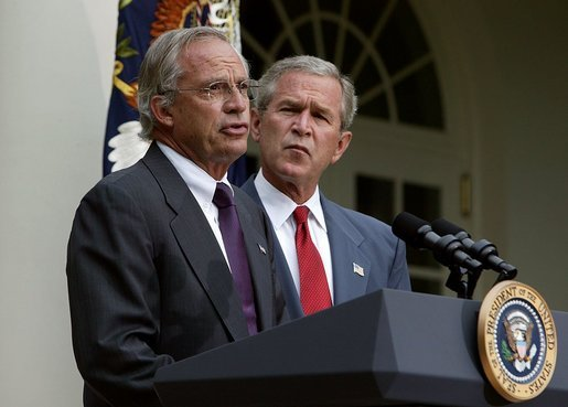 Standing with President George W. Bush, Rep. Porter Goss, R-Fla., addresses the media after the President nominated him to be the director of the CIA in the Rose Garden, Tuesday, Aug. 10, 2004. White House photo by Joyce Naltchayan.