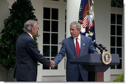 Nominating Rep. Porter Goss, R-Fla., to be the director of the CIA, President George W. Bush extends his hand to him during the Rose Garden announcement Tuesday, Aug. 10, 2004.  White House photo by Joyce Naltchayan