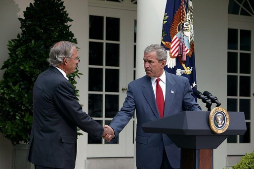 Nominating Rep. Porter Goss, R-Fla., to be the director of the CIA, President George W. Bush extends his hand to him during the Rose Garden announcement Tuesday, Aug. 10, 2004. White House photo by Joyce Naltchayan.