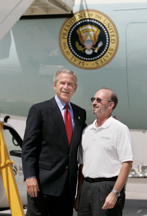 President George W. Bush meets Freedom Corps Greeter Mike Peschl in front of Air Force One in Las Vegas, Nevada, Thursday, Aug. 12, 2004. Peschl has been an active volunteer with Habitat for Humanity of Las Vegas since 1996. White House photo by Eric Draper
