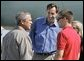 President George W. Bush meets Freedom Corps Greeter Chris Dudley, center, and Tyler Byrne, 17, at the Portland Air National Guard Base in Portland, Ore., Friday, Aug. 13, 2004. Mr. Dudley started The Dudley Foundation in 1994 to help children succeed regardless of economic, education, or health liabilities. One of the foundation's key projects is the creation of the first basketball camp for boys and girls with diabetes. Tyler takes part in the program. White House photo by Eric Draper.