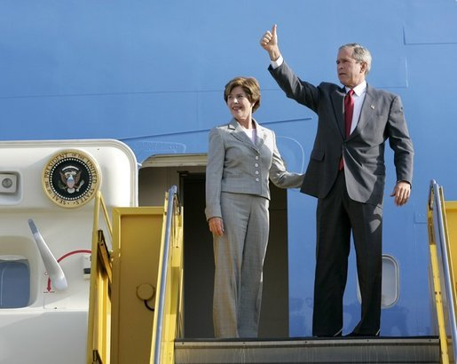 President George W. Bush gives a thumbs-up sign as he and Laura Bush depart Los Angeles Friday morning, Aug. 13. 2004. White House photo by Eric Draper.