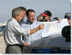 President George W. Bush receives a briefing on hurricane damage from FEMA Director Mike Brown in Punta Gorda, Florida, Sunday, Aug. 15, 2004.  White House photo by Eric Draper