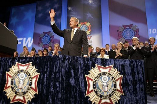President George W. Bush reacts to the response of the audience before speaking to the Veterans of Foreign Wars convention in Cincinnati, Ohio, Monday, Aug. 16, 2004. White House photo by Paul Morse.