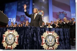 President George W. Bush reacts to the response of the audience before speaking to the Veterans of Foreign Wars convention in Cincinnati, Ohio, Monday, Aug. 16, 2004.  White House photo by Paul Morse