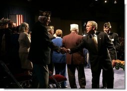 President George W. Bush greets veterans after speaking to the Veterans of Foreign Wars convention in Cincinnati, Ohio, Monday, Aug. 16, 2004.  White House photo by Paul Morse