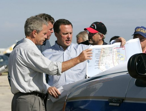 President George W. Bush receives a briefing on hurricane damage from FEMA Director Mike Brown in Punta Gorda, Florida, Sunday, Aug. 15, 2004. White House photo by Eric Draper.