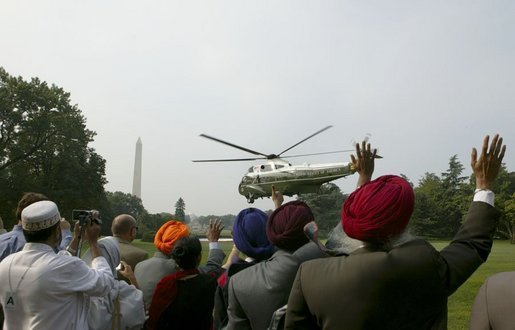 Before attending a meeting with administration officials, Sikh religious and community leaders watch as President George W. Bush departs the White House aboard Marine One Wednesday, Aug. 18, 2004. White House photo by Tina Hager.