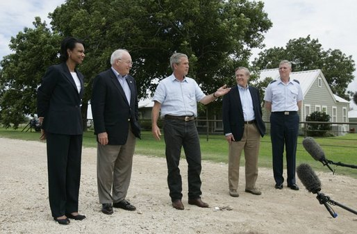 Standing with his national defense team, President George W. Bush talks with the press at Prairie Chapel Ranch in Crawford, Texas, Monday, Aug. 23, 2004. Pictured, from left, are: Dr. Condoleezza Rice, Vice President Dick Cheney, Secretary of Defense Donald Rumsfeld and Chairman of the Joint Chiefs of Staff General Richard Meyers. White House photo by Paul Morse.