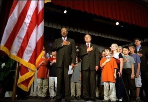 "President George W. Bush and Education Secretary Rod Paige recite the ""Pledge of Allegiance"" with students at the East Literature Magnet School in Nashville, Tennessee. White House File Photo. White House photo by Paul Morse."