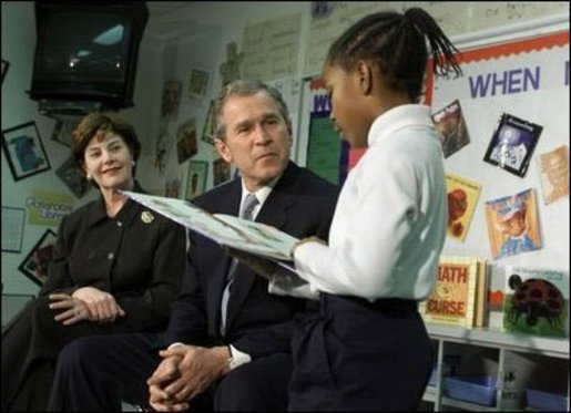 President Bush and Laura Bush listen to student Janea Bufford read at Moline Elementary School in St.Louis, Missouri. White House File Photo. White House photo by Paul Morse.