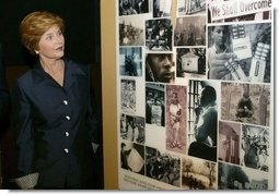 "Laura Bush tours the exhibit, ""From Slavery to Freedom,"" at the National Underground Railroad Freedom Center prior to dedication ceremonies in Cincinnati, Ohio, Monday, Aug. 23, 2004.  White House photo by Joyce Naltchayan"
