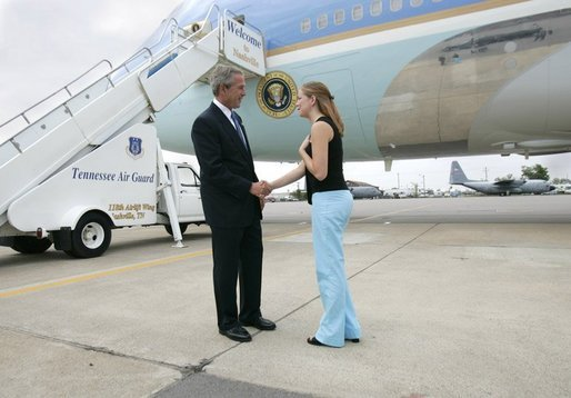President George W. Bush meets Freedom Corps greeter Andrea Martin in front of Air Force One at Nashville International Airport-Tennessee Air National Guard, Tuesday, Aug. 31, 2004. Martin, 21, volunteers with Mercy Ministries, a non-profit, faith-based ministry for girls aged 13 to 28 who are struggling with drug and alcohol abuse, unplanned pregnancies, eating disorders, abuse, or suicidal tendencies. White House photo by Eric Draper.