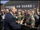 President George W. Bush greets base personnel and their families before departing Nashville International Airport-Tennessee Air National Guard, Tuesday, Aug. 31, 2004. White House photo by Eric Draper.