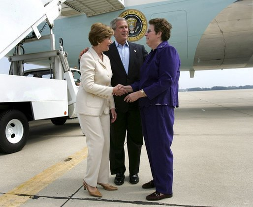 President George W. Bush introduces Mrs. Bush to USA Freedom Corps Greeter Kathy Hawkins in front of Air Force One at General Mitchell International Airport - Air Reserve Station in Milwaukee, Wisconsin, Friday, Sept. 3, 2004. Hawkins has volunteered with the Wisconsin State Veterans Home in King, Wisconsin for the past 20 years. White House photo by Eric Draper