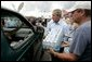 President George W. Bush helps to deliver water to a waiting motorist at an emergency relief center in Ft. Pierce, Fla., while touring relief efforts in response to Hurricane Frances damage, Wednesday, Sept. 8, 2004. White House photo by Eric Draper