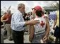 President George W. Bush talks to an American Red Cross worker while touring relief efforts in response to Hurricane Frances damage in Ft. Pierce, Fla., Wednesday, Sept. 8, 2004. White House photo by Eric Draper