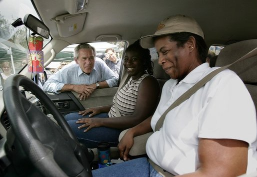 President George W. Bush visits with vicitims of Hurricane Frances at an emergency relief center in Ft. Pierce, Fla., Wednesday, Sept. 8, 2004. White House photo by Eric Draper