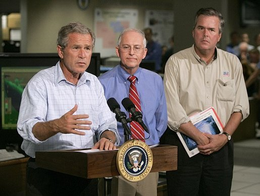 President George W. Bush delivers a live statement to Floridians affected by Hurricane Frances at the National Hurricane Center in Miami, Fla., Wednesday, Sept. 8, 2004. Also pictured from left are Max Mayfield Director of the National Hurricane Center and Florida Gov. Jeb Bush. White House photo by Eric Draper