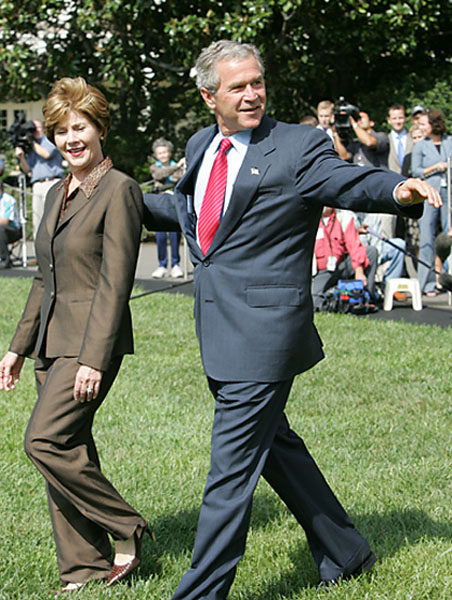 President George W. Bush and Laura Bush wave before departing the South Lawn on Marine One Thursday, Sept. 9, 2004. White House photo by Paul Morse.