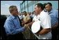 President George W. Bush greets military personnel at the Willow Grove Naval Air Station in Pennsylvania before boarding Air Force One en route to Johnstown, Pa., Thursday, Sept. 9, 2004. White House photo by Tina Hager.