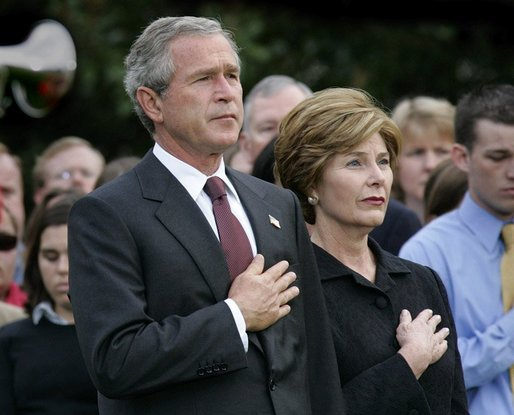 President George W. Bush and Mrs. Bush pause during the playing of Taps following the Moment of Silence on the South Lawn, Saturday, Sept. 11, 2004. White House photo by Eric Draper.