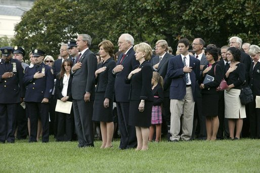 President George W. Bush, Mrs. Bush, Vice President Dick Cheney and Mrs. Cheney, stand by families of victims of 911 during the playing of Taps following a Moment of Silence on the South Lawn, Saturday, Sept. 11, 2004. White House photo by David Bohrer.