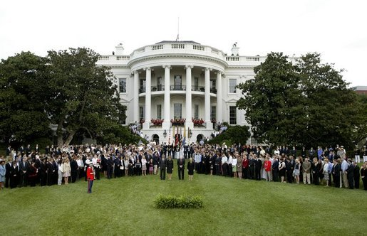 President George W. Bush, Mrs. Bush, Vice President Dick Cheney and Mrs. Cheney, center, are joined by White House staff and families of victims of 911 for a Moment of Silence on the South Lawn at 8:46am, Saturday, Sept. 11, 2004. White House photo by Tina Hager