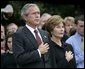 President George W. Bush and Mrs. Bush pause during the playing of Taps following the Moment of Silence on the South Lawn, Saturday, Sept. 11, 2004. White House photo by Eric Draper