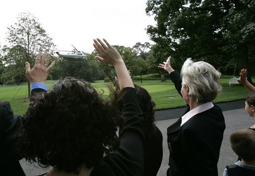 Families of victims of 911 wave goodbye as President George W. Bush and Mrs. Bush depart the White House aboard Marine One, Saturday, Sept. 11, 2004. White House photo by Eric Draper