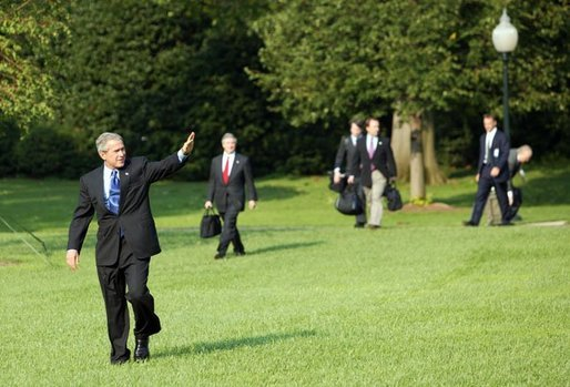 President George W. Bush and staff depart the White House South Lawn aboard Marine One Monday, Sept. 13, 2004. White House photo by Tina Hager.
