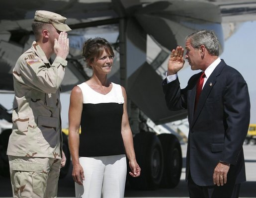 President George W. Bush returns the salute from National Guardsman Joshua Bunker while meeting his mother, Freedom Corps Greeter Theresa Bunker, at Las Vegas-McCarran International Airport, Sept. 14, 2004. White House photo by Eric Draper