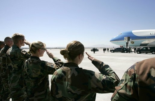 Military personnel from Nellis Air Force Base salute President George W. Bush as he boards Air Force One before departing Las Vegas, Nev., Tuesday, Sept. 14, 2004. White House photo by Eric Draper