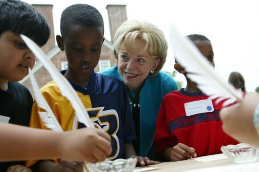 Gunston Elementary School students Aqial Ahmed, left, Abel Aklilu, center, and Abrham Meagistu practice their penmanship using quill pens at Gunston Hall Plantation, the historic home of Founding Father George Mason, Friday, Sept. 17, 2004. Lynne Cheney hosted 200 third grade students from schools in Northern Virginia for Constitution Day, an annual interactive program designed to educate students on America's history through Constitution-era games and activities. White House photo by Tina Hager