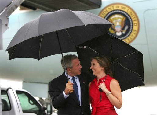 President George W. Bush talks with USA Freedom Corps Greeter Crystal Regan after arriving aboard Air Force One at Charlotte-Douglas International Aiport - Air National Guard Base, Friday, Sept. 17, 2004. Ms. Regan volunteers at East Lincoln Pregnancy Counseling Center, teaching parenting, nutrition, budgeting classes and counseling clients with unplanned pregnancies. White House photo by Eric Draper