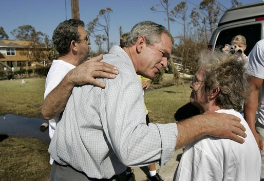 President George W. Bush comforts residents during a walking tour of neighborhoods damaged by Hurricane Ivan in Pensacola, Florida, Sunday, Sept. 19, 2004. White House photo by Eric Draper