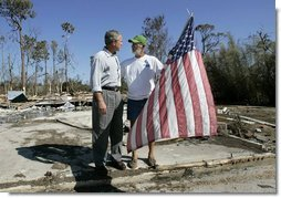 President George W. Bush talks with resident Jim Heinold during a walking tour of neighborhoods damaged by Hurricane Ivan in Pensacola, Florida, Sunday, Sept. 19, 2004  White House photo by Eric Draper
