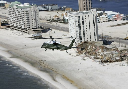 President George W. Bush aboard Marine One takes an aerial tour of damage caused by Hurricane Ivan in Orange Beach, Alabama, Sunday, Sept. 19, 2004. White House photo by Eric Draper