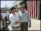 President George W. Bush greets Arthur Bourne, Police Chief of Gulf Shores, during a visit with First Responders at the Orange Beach Fire and Rescue Station 1 in Orange Beach, Alabama Sunday, Sept. 19, 2004. White House photo by Eric Draper
