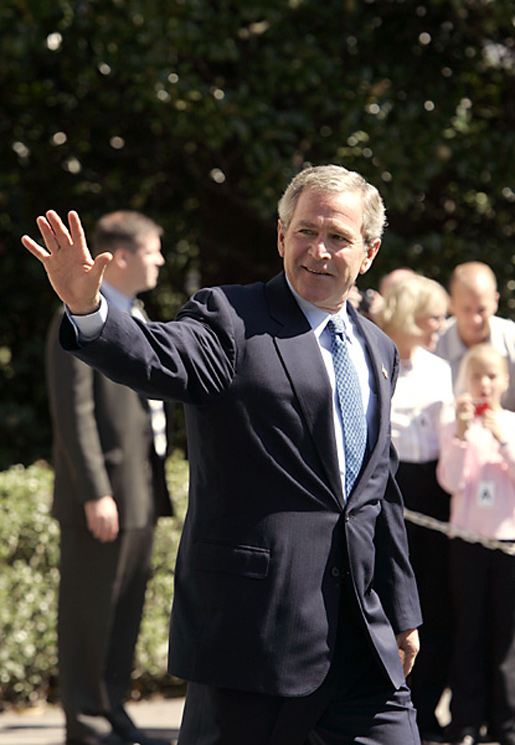President George W. Bush waves as he departs the South Lawn aboard Marine One Monday, Sept. 20, 2004. White House photo by Paul Morse