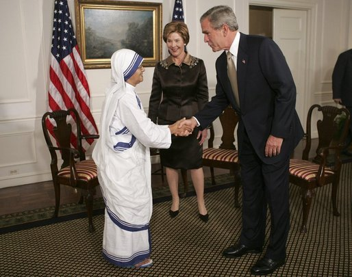 President George W. Bush and Mrs. Bush greet Sister Nirmala, Superior General of the Missionaries of Charity, in New York City Tuesday, Sept. 21, 2004. The mission was founded in 1950 by Mother Teresa in Calcutta, India. Sister Nirmala is Mother Teresa's successor. White House photo by Eric Draper.