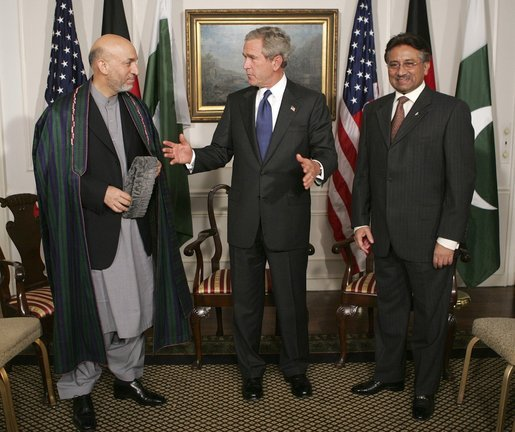 President George W. Bush meets with Presidents Hamid Karzai of Afghanistan, left, and Pervez Musharraf of Pakistan at the United Nations General Assembly Tuesday, Sept. 21, 2004. White House photo by Eric Draper.