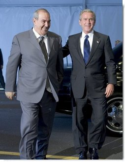 President George W. Bush and Iraqi interim Prime Minister Ayad Allawi arrive at the United Nations Headquarters in New York City Tuesday, Sept. 21, 2004.  White House photo by Paul Morse