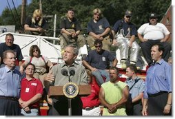 President George W. Bush discusses the recovery efforts at the Millvale, Pa. Fire Department in Western Pennsylvania during a visit to the area recently flooded by Tropical Depression Ivan in Allegheny County, Wednesday, Sept. 22, 2004.  White House photo by Eric Draper
